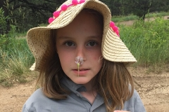AHTW-Girl with wildflower stuck to her noise