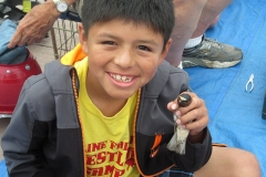 Bird banding-Boy close up smiling