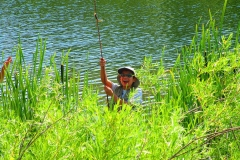 Fly Fishing Boy smiling with fish
