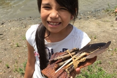 Longmont Timberline Girl with stick packet smiling