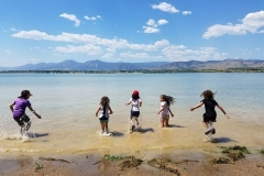 Magical Images-Girls jumping in lake