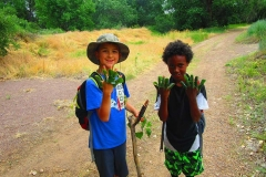 Wild Skills Boys with leaves on fingers